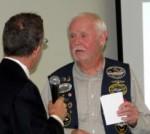 President Chris presents to Bob